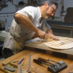 Peter in shop carving braces on sitka spruce top